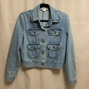 Vintage light wash denim jacket with front flap pockets and elbow detail